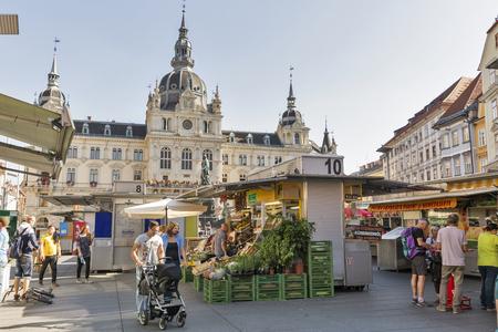 hauptplatz: GRAZ, AUSTRIA - SEPTEMBER 12, 2015: Unrecognized people visit street market on Hauptplatz square in front of Town Hall building. It is the main square of Graz, second largest city in Austria.
