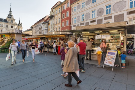 GRAZ, AUSTRIA - SEPTEMBER 12, 2015: Unrecognized people visit street market on Hauptplatz square. It is the main square of Graz, the capital of Styria and second largest city in Austria.