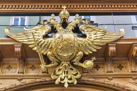 double headed eagle: GRAZ, AUSTRIA - SEPTEMBER 12, 2015: Double headed eagle at the entrance to Imperial and Royal Bakery Edegger-Tax on Hofgasse street. It is the oldest bakery in Graz and also one of Austrias oldest.