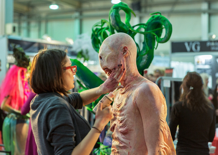 one eyed: KIEV, UKRAINE - FEBRUARY 05, 2016: Makeup woman prepare fantastic creature mask for competition at Kyiv Fashion 2016 in KyivExpoPlaza exhibition center, 30th edition of International Vogue Festival. Editorial