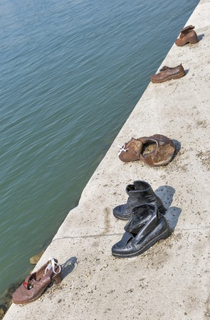 honors: BUDAPEST, HUNGARY - SEPTEMBER 24, 2015: The Iron Shoes on the Danube riverbank Memorial. Memorial honors the Jews killed during the Second World War. Editorial