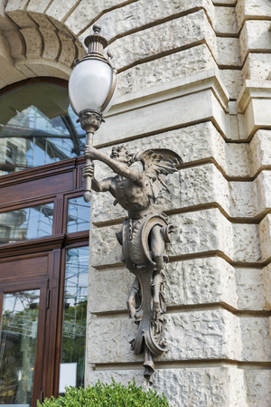 satire: street lamp in the form of mythological satire in Budapest, Hungary