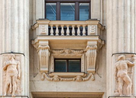 europe closeup: Old building exterior with balcony, columns and bas relief closeup. Vorosmarty ter square, Belvaros, central Budapest, Hungary, Europe.