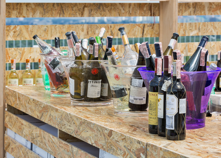 shelf ice: KIEV, UKRAINE - June 04, 2016: Different wines in ice buckets presented on the shelf of outdoor food court at Kyiv Wine Festival organized by Good Wine company in Parkovy Exhibition Center. Editorial