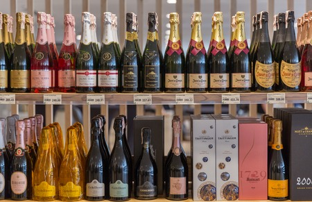 original sparkle: KIEV, UKRAINE - JUNE 04, 2016: Champagne and sparkling wine from different manufacturers presented on the store shelves at Kyiv Wine Festival organized by Good Wine company in Parkovy Exhibition Center