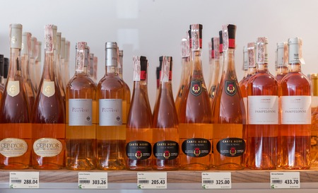 noire: KIEV, UKRAINE - JUNE 04, 2016: Rose wine from different manufacturers closeup presented on the store shelves at Kyiv Wine Festival organized by Good Wine company in Parkovy Exhibition Center.