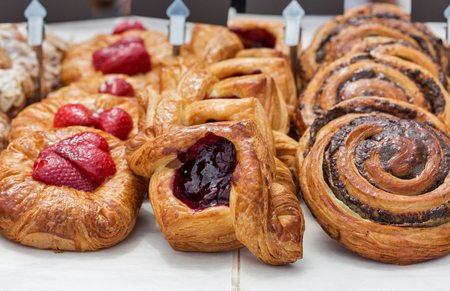 Freshly baked goods in organic bakery closeup