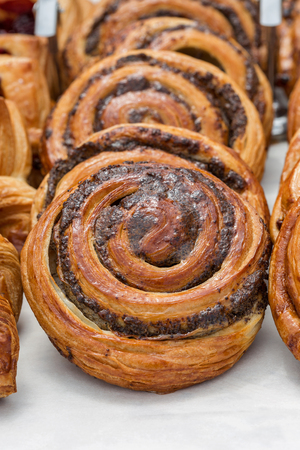 Freshly baked goods in organic bakery closeup