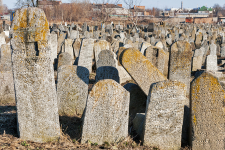 gravestones: Fallen gravestones of the ancient Jewish cemetery at sunset