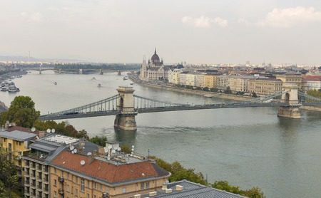 building a chain: Budapest cityscape with Chain Bridge, Parliament Building and Danube River, Hungary