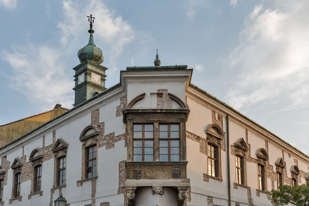 castle district: Beautiful building facade with old clock tower in Budapest, Buda Castle district, Hungary
