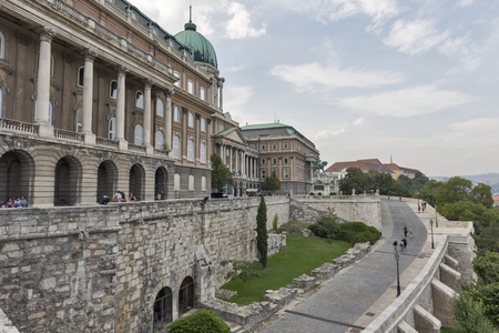 unrecognized: BUDAPEST, HUNGARY - SEPTEMBER 23, 2015: Unrecognized people walk along Royal Palace in Buda Castle. Budapest is the capital and largest city in Hungary. Editorial