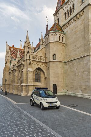 castle district: BUDAPEST, HUNGARY - SEPTEMBER 23, 2015: Police car Smart in front of Matthias church in Buda Castle district. Budapest is the capital and largest city in Hungary. Editorial