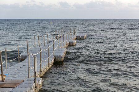 pontoon: Pontoon bridge for swimming. Mediterranean Sea in Paphos, Cyprus. Stock Photo