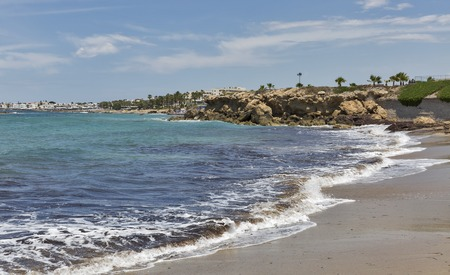 Beach with cityscape in Paphos, Cyprus.