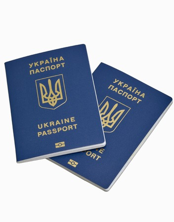 biometric: Ukrainian biometric passports isolated on white background closeup