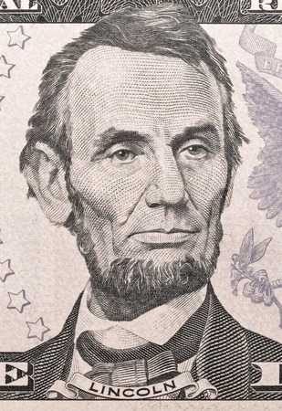 five dollar bill: US President Abraham Lincoln portrait on five dollar bill macro