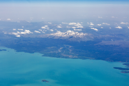 snow covered mountains: Aerial view from airplane of Lake Beysehir and snow covered mountains in Turkey. It is the largest freshwater lake in Turkey Stock Photo