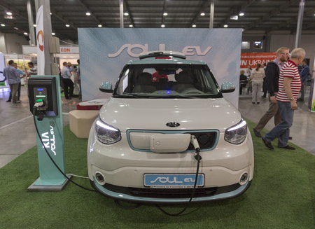 unrecognized: KIEV, UKRAINE - JUNE 10, 2016: Unrecognized visitors visit Kia Soul EV electric vehicle booth at First International Trade Show of Electric Vehicles Plug-In Ukraine in KyivExpoPlaza Exhibition Center.