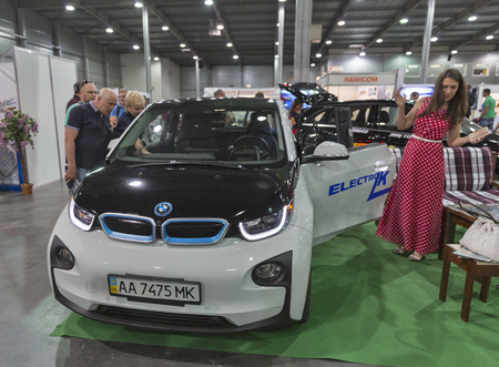 i3: KIEV, UKRAINE - JUNE 10, 2016: Visitors visit booth with BMW i3 electric hybrid car on display at 1st International Trade Show of Electric Vehicles Plug-In in KyivExpoPlaza Exhibition Center.