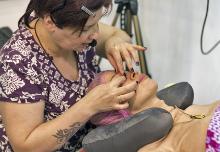 unrecognized: KIEV, UKRAINE - MARCH 25, 2016: Unrecognized woman cosmetologist demonstrates beauty treatments at 16th National Congress of Beauty Industry Estet Beauty Expo 2016 in IEC.