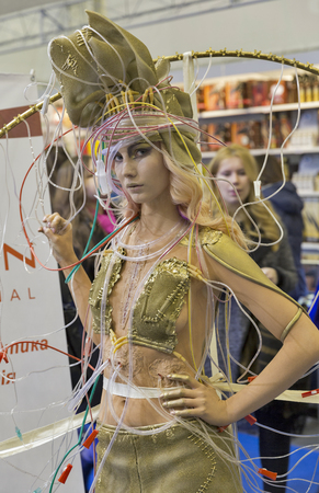 national congress: KIEV, UKRAINE - MARCH 25, 2016: Unrecognized young fashion model demonstrates futuristic dress at 16th National Congress of Beauty Industry Estet Beauty Expo 2016 in IEC.