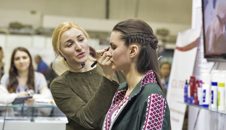 national congress: KIEV, UKRAINE - MARCH 25, 2016: Unrecognized woman cosmetologist demonstrates makeup blending skills at 16th National Congress of Beauty Industry Estet Beauty Expo 2016 in IEC.