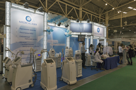 national congress: KIEV, UKRAINE - MARCH 25, 2016: Visitors visit MedicaLaser professional esthetic medicine equipment trade company booth at 16th National Congress of Beauty Industry Estet Beauty Expo 2016 in IEC.