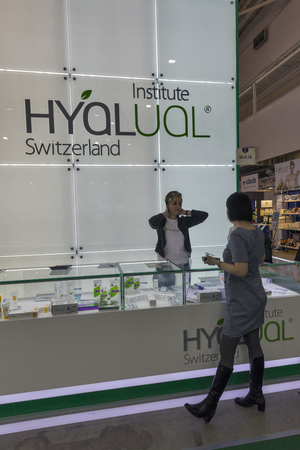 national congress: KIEV, UKRAINE - MARCH 25, 2016: Unrecognized visitor visits Hyalual Institute Swiss cosmetology company booth at 16th National Congress of Beauty Industry Estet Beauty Expo 2016 in IEC. Editorial