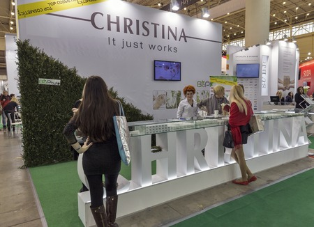 national congress: KIEV, UKRAINE - MARCH 25, 2016: Unrecognized visitors visit Christina cosmetics Israeli company booth at 16th National Congress of Beauty Industry Estet Beauty Expo 2016 in IEC.