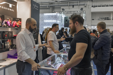 national congress: KIEV, UKRAINE - MARCH 25, 2016: Unrecognized visitors visit Y. S. Park professional hairdresser tools Japanese company booth at 16th National Congress of Beauty Industry Estet Beauty Expo 2016 in IEC.