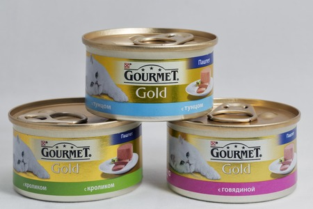 gold cans: KIEV, UKRAINE - AUGUST 08, 2016: Purina Gourmet Gold luxury pet food cans on white background. Formed in 2001 Purina Petcare is a subsidiary of Nestle. It is the largest pet food company in the USA.