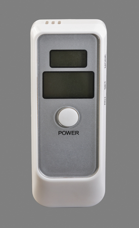 sobriety test: portable breath alcohol tester isolated on gray background closeup Stock Photo