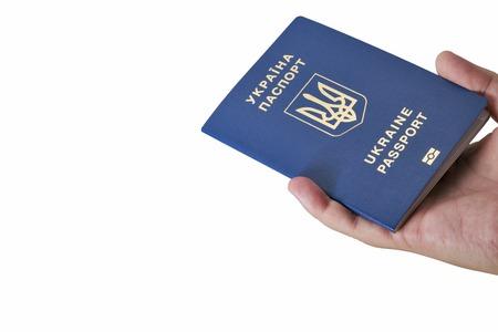 biometric: Hand holding Ukrainian biometric passport isolated on white background closeup with copy space