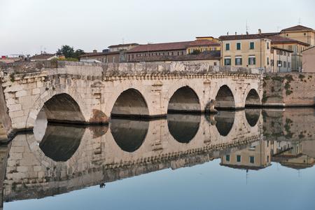 Bridge of Tiberius in Rimini at sunset, Italy.