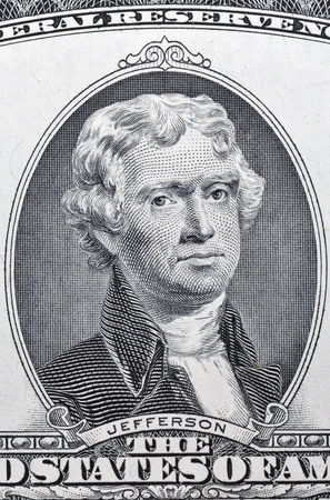 Portrait of the third US President Thomas Jefferson on two dollar banknote bill macro, front side obverse. Stock Photo