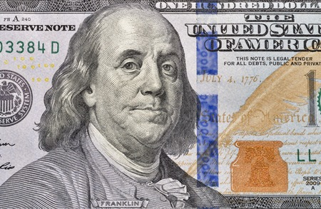 one hundred dollar bill: US President Benjamin Franklin portrait on one hundred dollar bill fragment macro