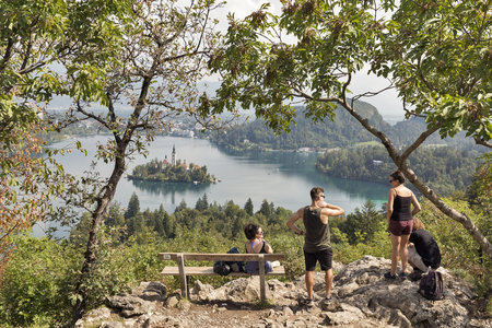 unrecognized: BLED, SLOVENIA - SEPTEMBER 10, 2016: Unrecognized young tourists visit observation point on Osojnica mountain, lake Bled. Bled Lake is one of the picturesque sites of the nation.