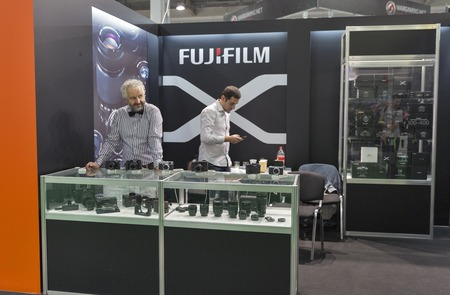 unrecognized: KIEV, UKRAINE - OCTOBER 09, 2016: Unrecognized presenters work on Fuji Film booth during CEE 2016, the largest electronics trade show of Ukraine in KyivExpoPlaza EC.