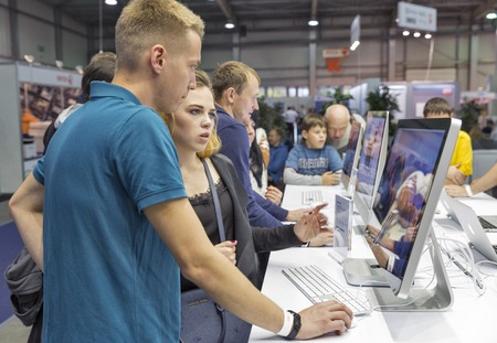 unrecognized: KIEV, UKRAINE - OCTOBER 09, 2016: Unrecognized people visit Apple, American multinational technology company booth during CEE 2016, the largest electronics trade show of Ukraine in KyivExpoPlaza EC. Editorial