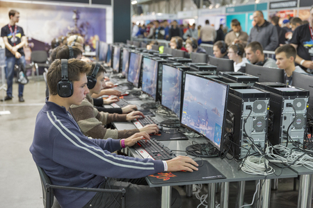 KIEV, UKRAINE - OCTOBER 09, 2016: Unrecognized people visit Wargaming company computer game zone during CEE 2016, the largest electronics trade show of Ukraine in KyivExpoPlaza EC.