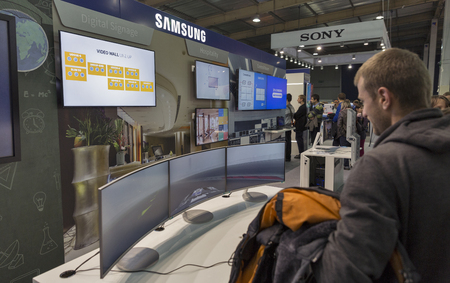 KIEV, UKRAINE - OCTOBER 09, 2016: Unrecognized people visit Samsung, Korean electronics manufacturer company booth during CEE CEE 2016, largest electronics trade show of Ukraine in KyivExpoPlaza EC.