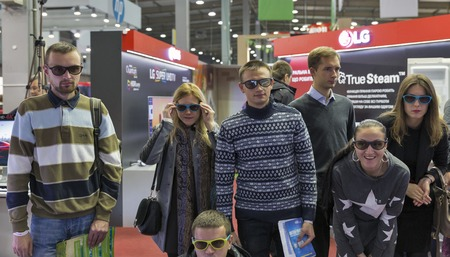 KIEV, UKRAINE - OCTOBER 09, 2016: People testing 3D TV glasses at LG, Korean multinational conglomerate corporation booth during CEE 2016, largest electronics trade show of Ukraine in KyivExpoPlaza EC Editorial
