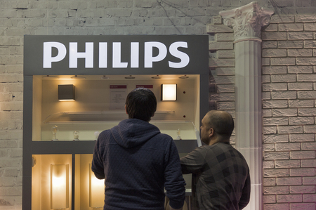 KIEV, UKRAINE - OCTOBER 09, 2016: Unrecognized people visit Philips Lighting, Dutch technology company booth during CEE 2016, the largest electronics trade show of Ukraine in KyivExpoPlaza EC. Editorial