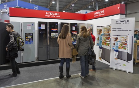 KIEV, UKRAINE - OCTOBER 09, 2016: Unrecognized people visit Hitachi, Japanese multinational conglomerate company booth during CEE 2016, largest electronics trade show of Ukraine in KyivExpoPlaza EC. Editorial