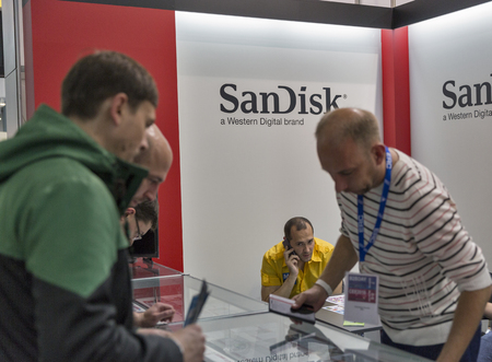 KIEV, UKRAINE - OCTOBER 09, 2016: Unrecognized people visit SanDisk, American electronics manufacturer company booth during CEE 2016, the largest electronics trade show of Ukraine in KyivExpoPlaza EC.