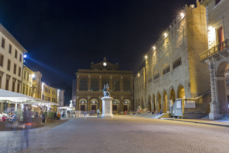 Cavour square with statue of Pope Paul V and public theater Amintore Galli at night in Rimini, Italy.
