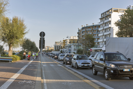 RIMINI, ITALY - SEPTEMBER 24, 2016: Traffic jams on Claudio Tintori waterfront street. Rimini is one of the most famous Adriatic Sea resorts in Europe thanks to its 15 km sandy beach.