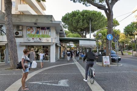 RIMINI, ITALY - SEPTEMBER 24, 2016: People walk along Amerigo Vespucci Avenue with shops and restaurants. Rimini is one of the most famous Adriatic Sea resorts in Europe thanks to 15 km sandy beach. Editorial