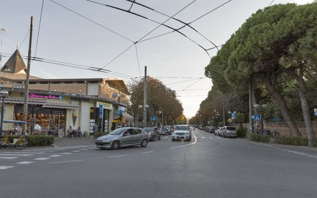RIMINI, ITALY - SEPTEMBER 24, 2016: People walk along Prince Amedeo Avenue with shops and cafes. Rimini is one of the most famous Adriatic Sea resorts in Europe thanks to its 15 km sandy beach.